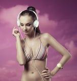 Summer girl listening music Stock Photography
