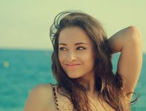 Summer girl looking happy on blue. Sea and sky background. Closeup vintage portrat Stock Photography