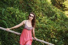 Summer girl in the Park. Beautiful young woman in a sundress stock image