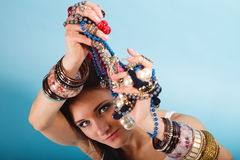 Summer girl with plenty of jewellery, beads in hands Stock Photo