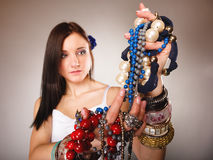 Summer girl with plenty of jewellery, beads in hands Stock Photography