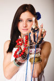 Summer girl with plenty of jewellery, beads in hands Royalty Free Stock Photos