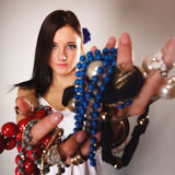 Summer girl with plenty of jewellery, beads in hands Stock Image