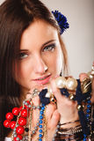 Summer girl with plenty of jewellery, beads in hands Royalty Free Stock Image
