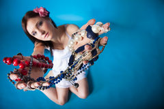 Summer girl plenty of jewellery beads in hands Stock Photos