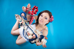 Summer girl plenty of jewellery beads in hands Royalty Free Stock Photos