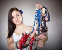 Summer girl plenty of jewellery beads in hands Stock Images