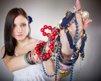 Summer girl plenty of jewellery beads in hands Stock Photo