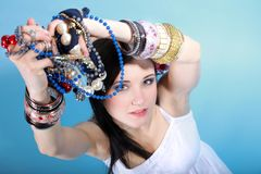 Summer girl plenty of jewellery beads in hands Stock Photography