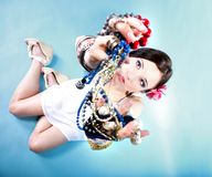 Summer girl plenty of jewellery beads in hands Royalty Free Stock Image
