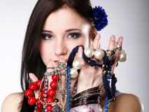 Summer girl plenty of jewellery beads in hands Royalty Free Stock Photo
