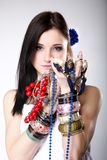 Summer girl plenty of jewellery beads in hands Royalty Free Stock Photography