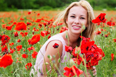 Summer girl in poppy field Stock Photography