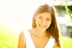 Summer girl portrait. Asian woman smiling happy on sunny summer or spring day outside in park by lake. Pretty mixed race Caucasian / Chinese Asian young woman royalty free stock photography
