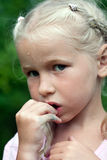 Summer girl portrait. Closeup face of little fair-haired girl Stock Photography