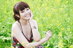 Summer girl in rape field. Royalty Free Stock Photos