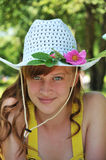 Summer. Girl's portrait in blue hat Stock Photo