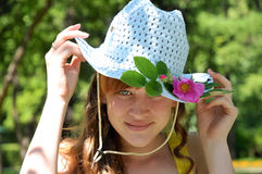 Summer. Girl's portrait in blue hat Stock Image