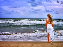 Summer girl sea go on water Royalty Free Stock Photography