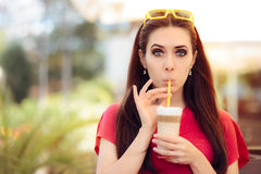 Summer Girl and Sipping Coffee Drink Trough a Straw stock images