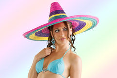 Summer girl with sombrero. Summer portrait of a cute girl wearing a bikini colored scarf and a big colorful hat like a sombrero Stock Photos