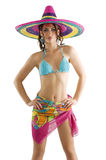 Summer girl with sombrero. Summer portrait of a cute girl wearing a bikini colored scarf and a big colorful hat like a sombrero Stock Photo