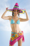 Summer girl with sombrero. Summer portrait of a cute girl wearing a bikini colored scarf and a big colorful hat like a sombrero Stock Image