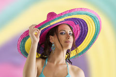 Summer girl with sombrero. Summer portrait of a cute girl wearing a bikini colored scarf and a big colorful hat like a sombrero royalty free stock image