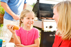 Summer: Girl Talking with Mother Before Eating Stock Photo
