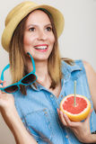 Summer. Girl tourist drinking grapefruit juice Royalty Free Stock Images