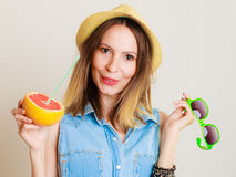 Summer girl tourist holding grapefruit citrus fruit Stock Images