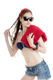 Summer girl wearing black glasses and denim shorts Stock Photography