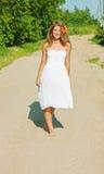 Summer girl in white dress Stock Photos