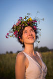 Girl with wreath in summer. Girl with wreath on the head looking up for the sky in summer evening royalty free stock image
