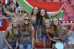 Summer girls. The girls with the leopard skin tops really enjoy themselves at the Rugby Sevens world series at nelson mandela bay staduim in Port Elizabeth.The Stock Photography