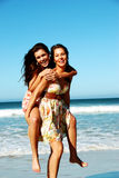Summer girls playing in the sea Royalty Free Stock Image