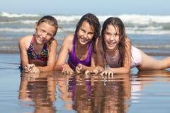Summer girls. Three happy girls on the beach stock photos