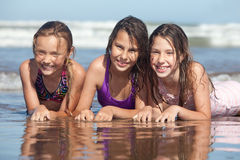 Summer girls. Three happy girls on the beach royalty free stock photography
