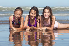 Summer girls. Three happy girls on the beach stock images