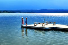 Summer girls. Two summer girls at the lake Royalty Free Stock Image