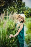 Girls in straw hats stock images
