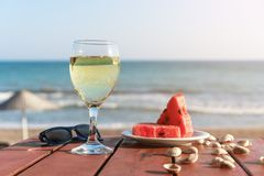 Summer, a glass of champagne and fruit against the background of the sea. stock photo