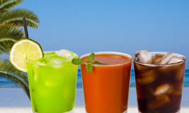 Summer glasses with drinks. Different summer drinks with attractive colors Royalty Free Stock Images