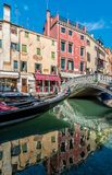 Summer gondola on canale with romantic bridge Royalty Free Stock Photography