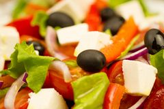 summer Greek salad with olives and feta cheese Royalty Free Stock Image