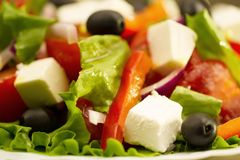 Summer Greek salad with olives and feta cheese Royalty Free Stock Photos