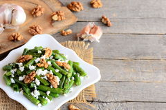 Summer green bean salad recipe. Balsamic green beans salad with cottage cheese, peeled walnuts, garlic and spices Stock Photos