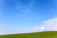 Summer green mountainside and cloudy sky Royalty Free Stock Images