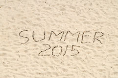 Summer 2015 handmade from conifer cones on sand Stock Photos