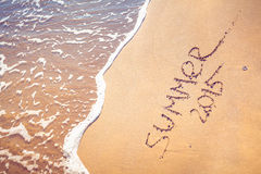 Summer 2015 handwriting on the sand. Royalty Free Stock Photography